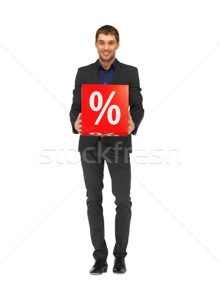 handsome man in suit with percent sign Stock photo © dolgachov