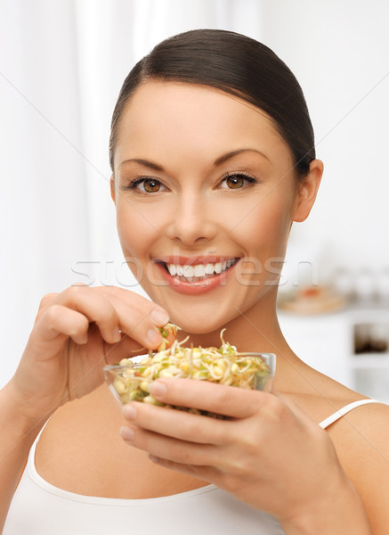 woman with mung sprout beans Stock photo © dolgachov