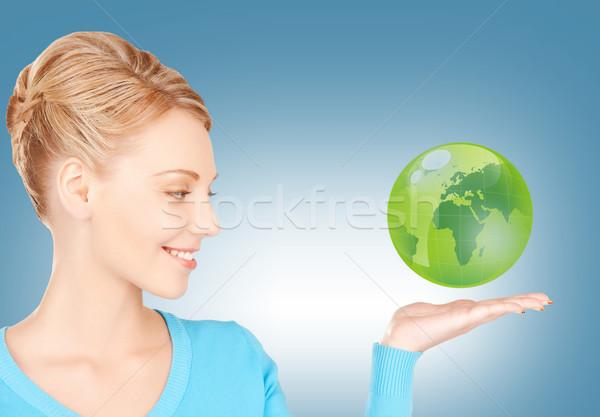 woman holding green globe on her hand Stock photo © dolgachov
