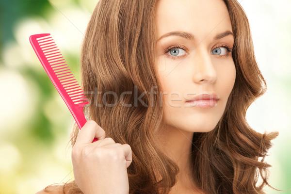Güzel bir kadın tarak parlak resim kadın yüz Stok fotoğraf © dolgachov