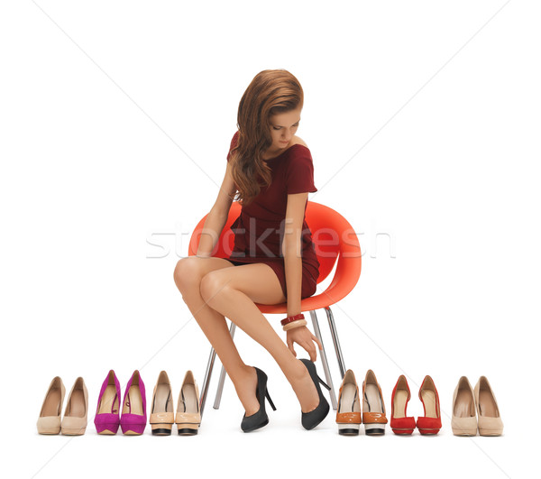 woman trying on high heeled shoes Stock photo © dolgachov