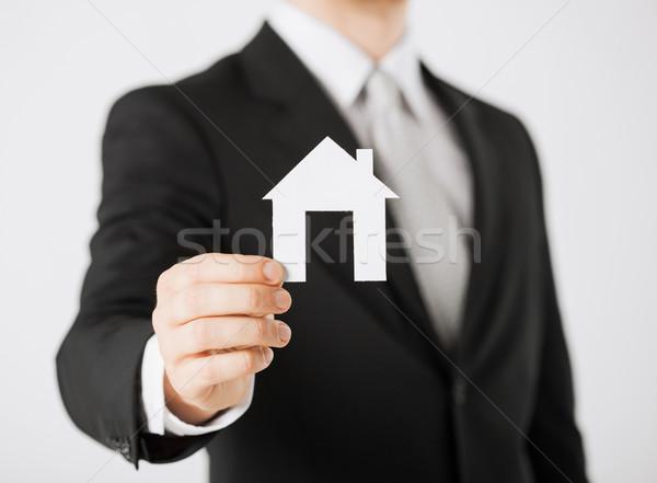man hand holding paper house Stock photo © dolgachov