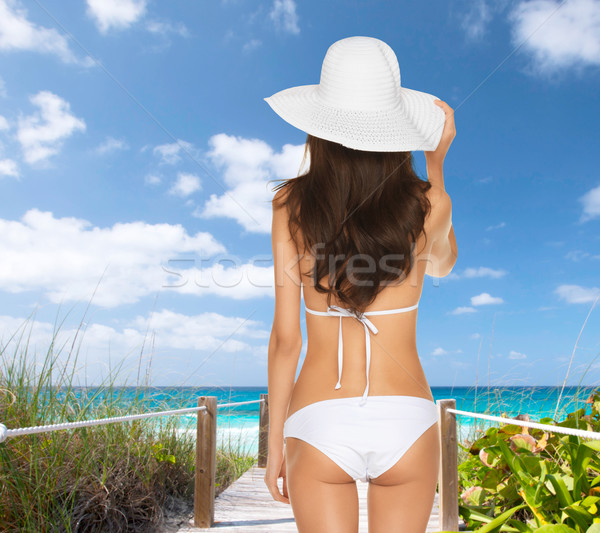 beutiful woman posing in white bikini Stock photo © dolgachov