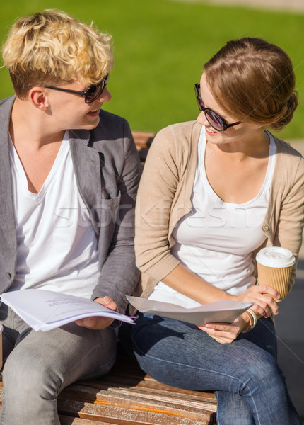 Stock photo: two students with books, notebooks and folders
