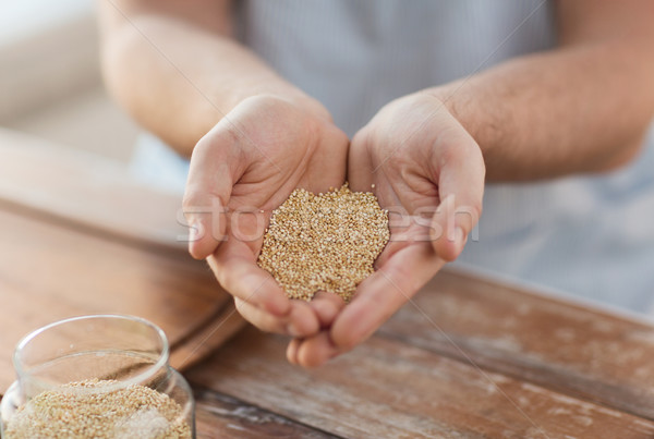 cloes up of male cupped hands with quinoa Stock photo © dolgachov