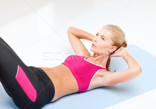 sporty woman doing exercise on the floor Stock photo © dolgachov