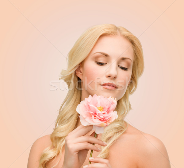 lovely woman with peony flower Stock photo © dolgachov