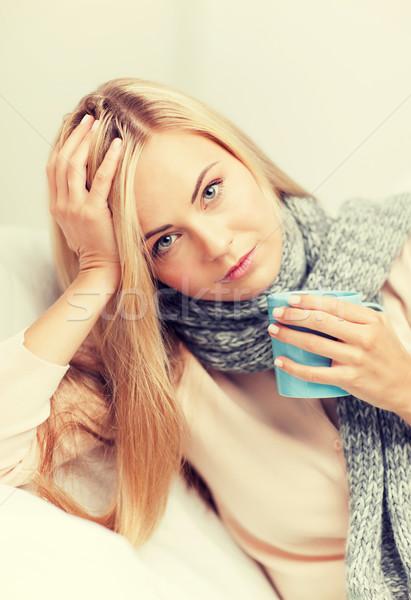 diseased woman with cup of tea Stock photo © dolgachov