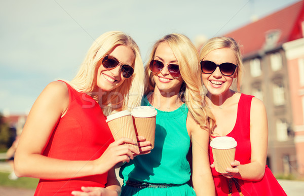 women with takeaway coffee cups in the city Stock photo © dolgachov