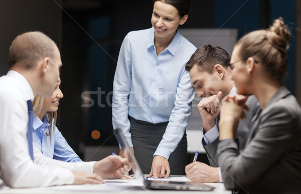 smiling female boss talking to business team Stock photo © dolgachov