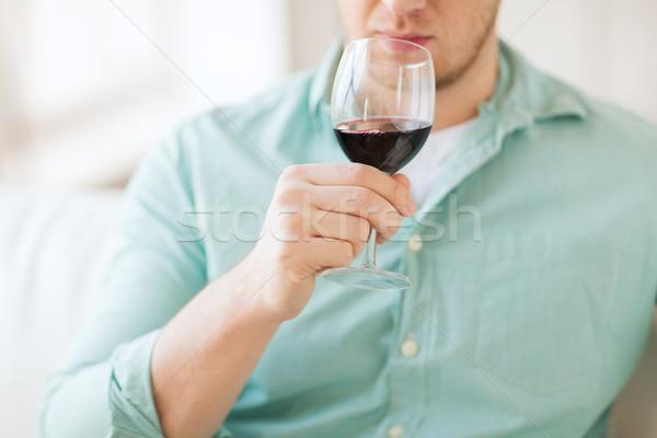 close up of man drinking wine at home Stock photo © dolgachov