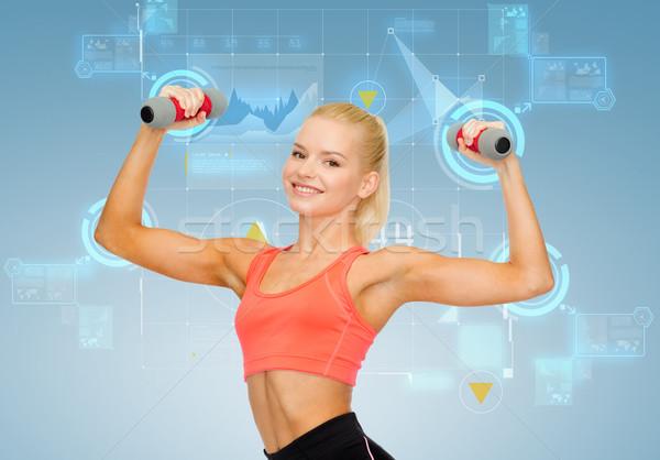 Sorridere bella donna manubri fitness Foto d'archivio © dolgachov