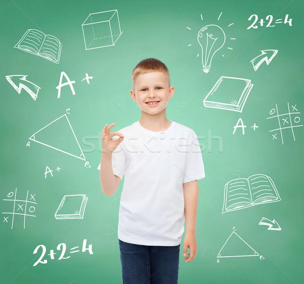 little boy in white t-shirt making ok gesture Stock photo © dolgachov