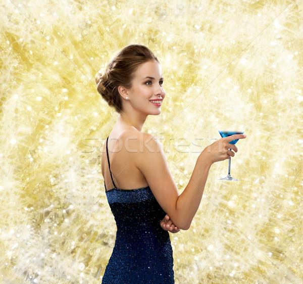Mujer sonriente vestido de noche cóctel bebidas Navidad Foto stock © dolgachov