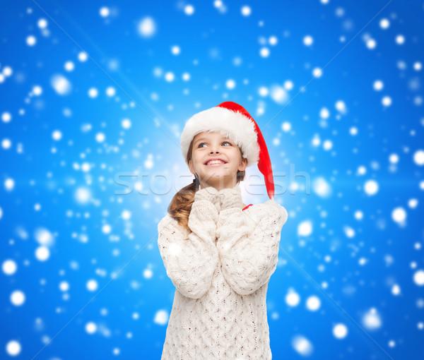 dreaming girl in santa helper hat Stock photo © dolgachov
