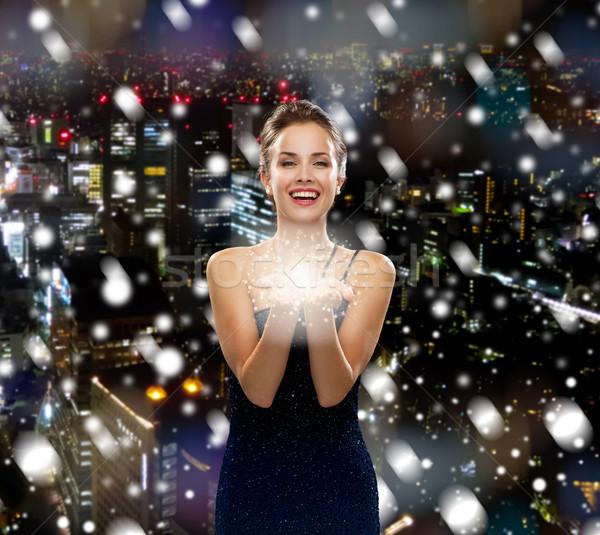 Сток-фото: смеясь · женщину · вечернее · платье · что-то · праздников