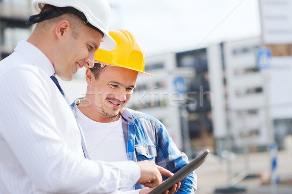 Sorridente construtores negócio edifício trabalho em equipe Foto stock © dolgachov
