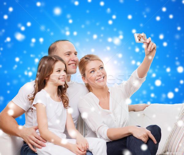 счастливая семья камеры домой семьи праздников Рождества Сток-фото © dolgachov