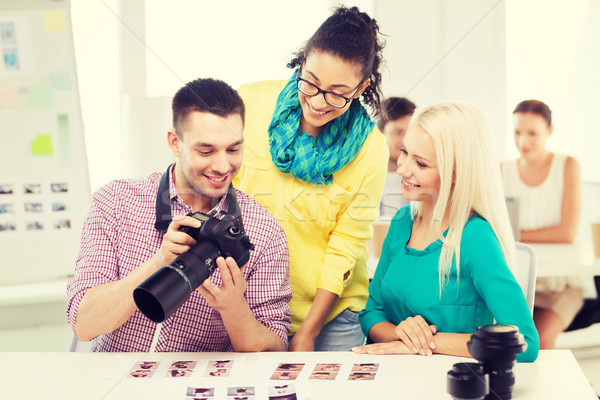 smiling team with photocamera working in office Stock photo © dolgachov