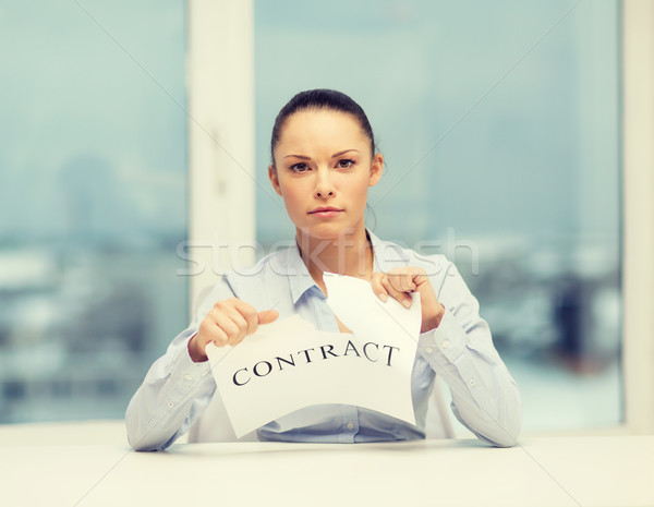 serious businesswoman tearing contract Stock photo © dolgachov