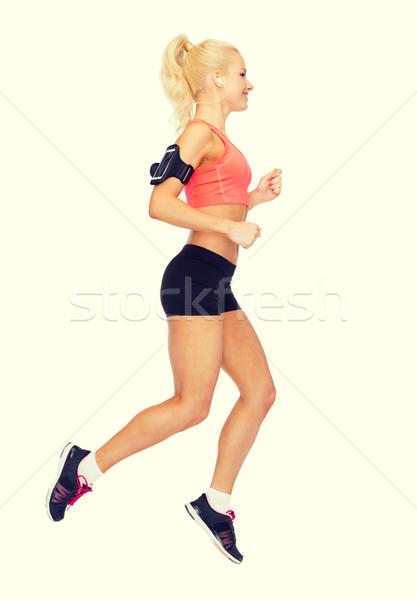 Vrouw lopen smartphone sport Stockfoto © dolgachov