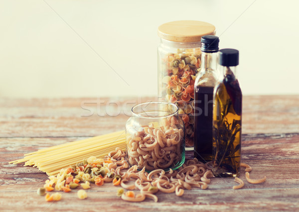 close up of two olive oil bottles and pasta in jar Stock photo © dolgachov