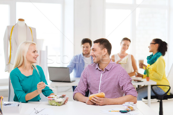 smiling fashion designers having lunch at office Stock photo © dolgachov