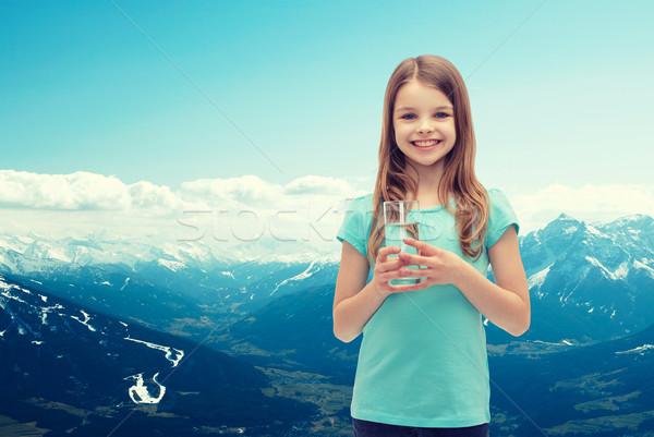 Uśmiechnięty dziewczynka szkła wody zdrowia piękna Zdjęcia stock © dolgachov