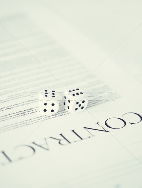 contract paper with gambling dices Stock photo © dolgachov