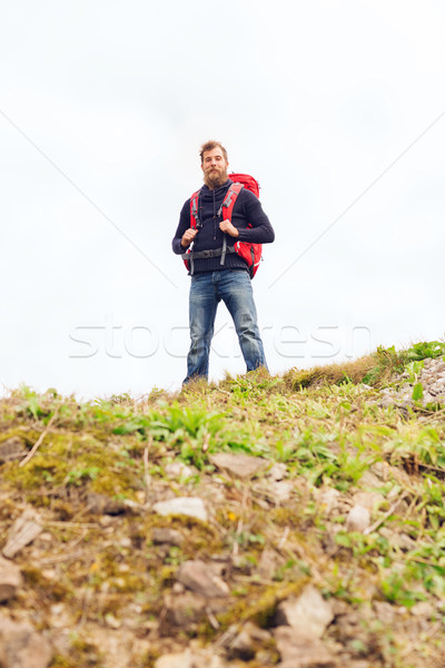 tourist with beard and backpack raising hands Stock photo © dolgachov
