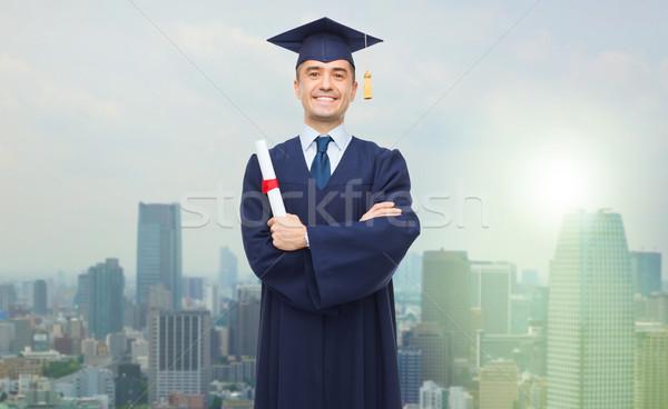 Sonriendo adulto estudiante diploma educación graduación Foto stock © dolgachov