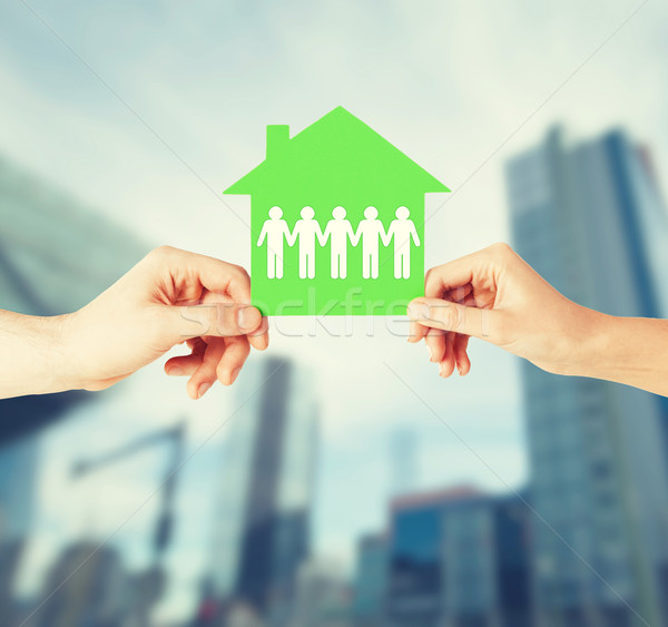 man and woman hands with paper house Stock photo © dolgachov