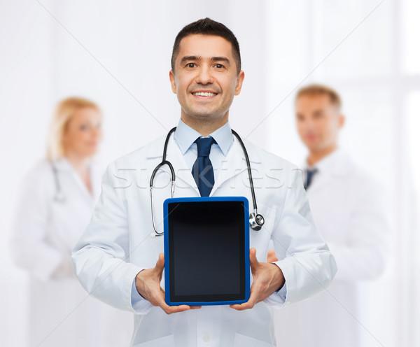 笑みを浮かべて 男性医師 病院 薬 職業 ストックフォト © dolgachov