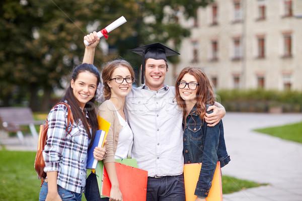 Mutlu Öğrenciler diploma klasörler eğitim Stok fotoğraf © dolgachov