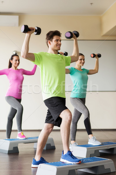 group of people with dumbbells and steppers Stock photo © dolgachov