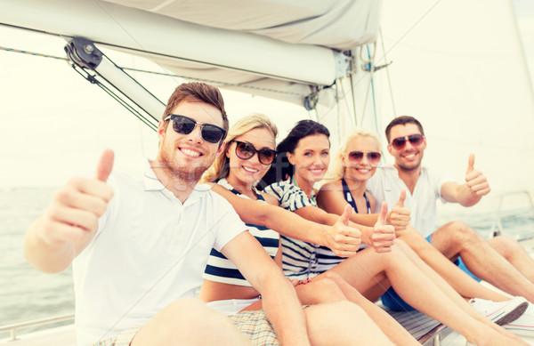 Mosolyog barátok jacht mutat remek utazás Stock fotó © dolgachov