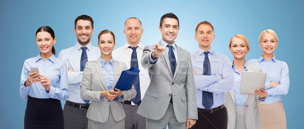 Grupo feliz gente de negocios senalando empresarial trabajo en equipo Foto stock © dolgachov