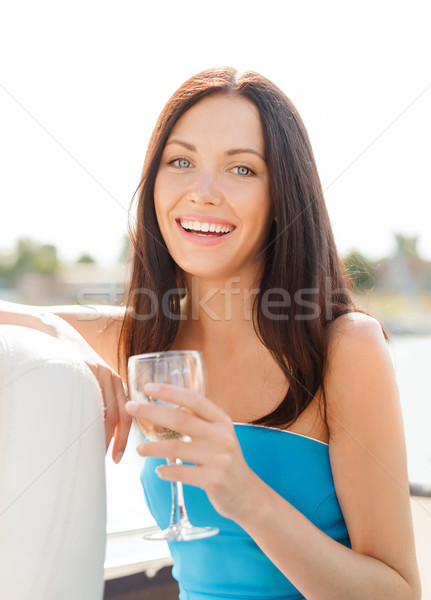 laughing girl with champagne glass Stock photo © dolgachov
