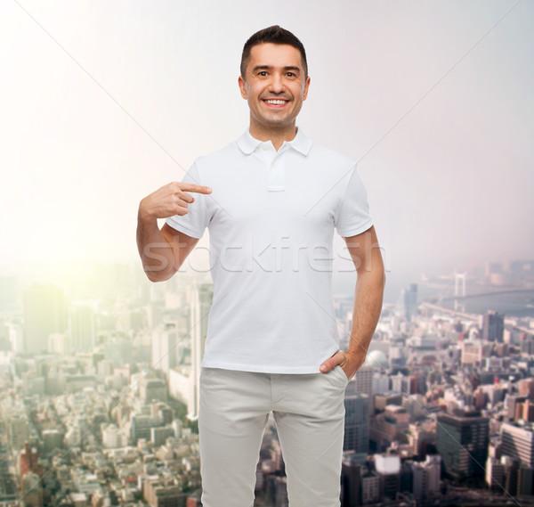 smiling man in t-shirt pointing finger on himself Stock photo © dolgachov