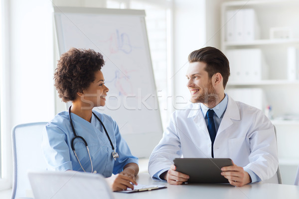 two happy doctors meeting at hospital office Stock photo © dolgachov