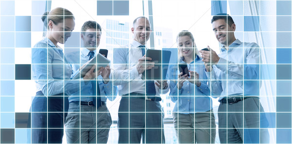 business people with tablet pc and smartphones Stock photo © dolgachov