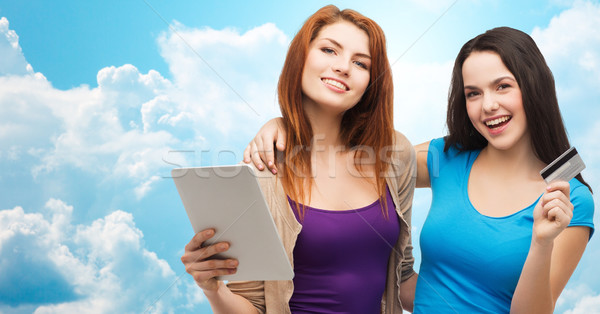two smiling girls with tablet pc and credit card Stock photo © dolgachov