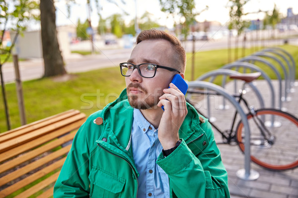 young hipster man with smartphone and byke Stock photo © dolgachov