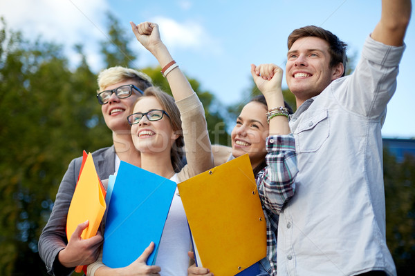 Stock photo: group of happy students showing triumph gesture