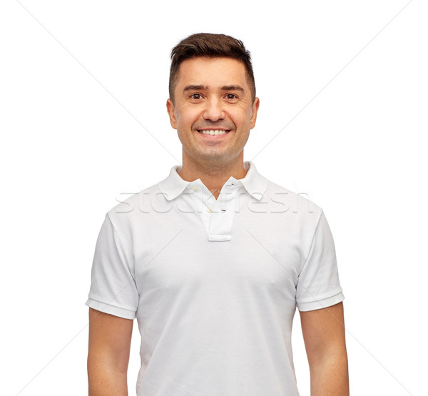 smiling man in white blank polo t-shirt Stock photo © dolgachov