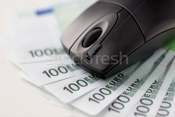 close up of computer mouse and euro cash money Foto stock © dolgachov