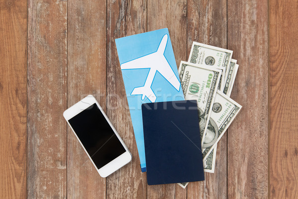 air ticket, money, smartphone and passport Stock photo © dolgachov