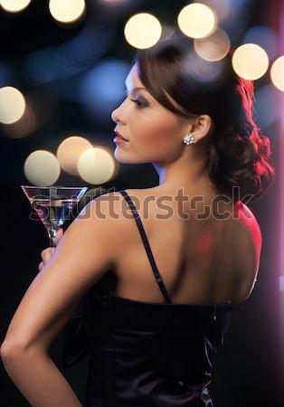 beautiful sexy woman in red dancing at nightclub Stock photo © dolgachov