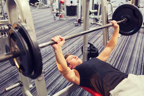 ストックフォト: 若い男 · 筋肉 · バーベル · ジム · スポーツ · ボディービル