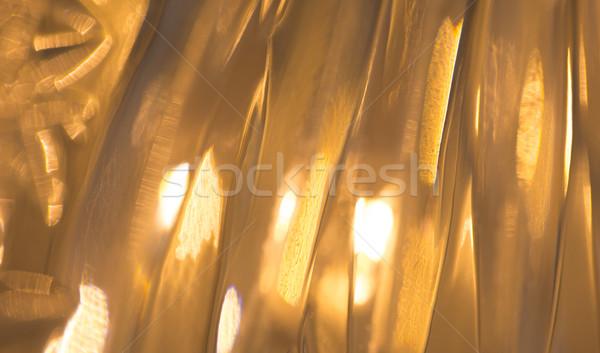 lights reflection on golden metallic background Stock photo © dolgachov